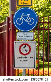 "Breda, Brabant, The Netherlands - April 19 2019: Entrance to Park Valkenberg with signs ""do not feed the animals"", ""camera surveillance"" and ""bicycle lane"""