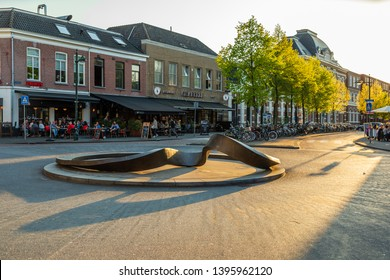 "Breda, Brabant, The Netherlands - April 19 2019: Roundabout at Van Coothplein. The bronze artwork ""Kalypso"" by Iris Bouwmeester is inspired by the myth of Kalypso from Homer's Odyssey"