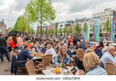 BREDA, NETHERLANDS, April 27, 2018: Many unidentified young and old  people on the terrace of the cafes during the celebration of King's Day.
