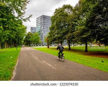 Breda, Netherlands - August 26, 2018: An unidentified cyclist cycling on streets of Breda, a city located in the province of North Brabant.