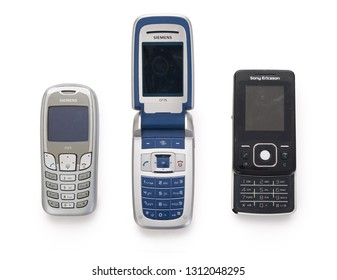 BREDA, NETHERLANDS - FEBRUARY 13: top view of SIEMENS and SONY ERICSSON vintage smart phone models from the late 90's, early 2000. Isolated on completely white background. Contains clipping path.