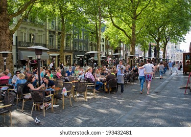 Breda, The Netherlands - May 18: People sitting and relaxing on the main square, the Grote Markt, and drinking a beer , on May 18, 2014 in Breda, Holland