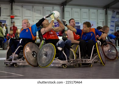 BREDA, NETHERLANDS - OCTOBER 12 : Dutch physically disabled athletes playing wheelchair rugby during the Paragames, a big bi-yearly event on OCTOBER 12, 2013 in BREDA, NETHERLANDS
