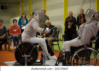 BREDA, NETHERLANDS - OCTOBER 12 : Dutch physically disabled athletes fencing during the Paragames, a big bi-yearly event on OCTOBER 12, 2013 in BREDA, NETHERLANDS