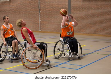BREDA, NETHERLANDS - OCTOBER 12 : Dutch physically disabled athletes playing wheelchair basketball during the Paragames, a big bi-yearly event on OCTOBER 12, 2013 in BREDA, NETHERLANDS