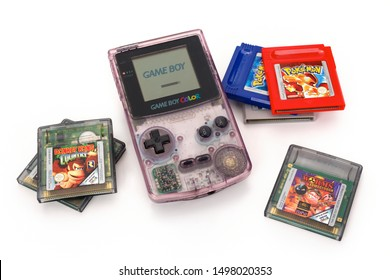 BREDA, NETHERLANDS - SEPTEMBER 06: Nintendo Game Boy Color, plus Pokemon, Donkey Kong and Worms cartridges. This was a handheld video game console for children in the 90s. Contains clipping path.