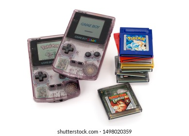 BREDA, NETHERLANDS - SEPTEMBER 06: Nintendo Game Boy Color devices, plus Pokemon, Donkey Kong cartridges. This was a popular handheld video game console for children in the 90s. Contains clipping path