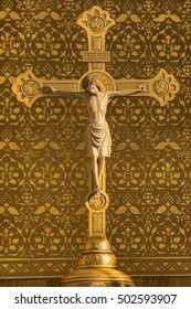 BREDA, THE NETHERLANDS - SEPTEMBER 10, 2016: Antique gold plated wooden crucifix on the altar of the St. Catherine Church