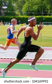 BREDA, NETHERLANDS-JUNE 2, 2012: Unidentified young athletes running during the Dutch National junior championship, June 2, 2012, Breda, The Netherlands