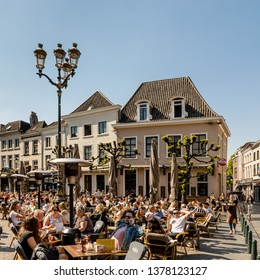 """Breda, North Brabant, The Netherlands - April 19 2019: """"Havermarkt"""", a popular square with cafés with terraces all around. It is also a famous nightlife spot"""
