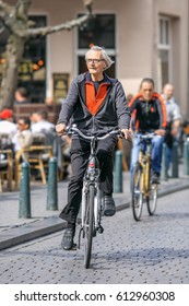 BREDA-MARCH 31, 2017. Male senior on his bike. Cycling is a ubiquitous mode of transport in the Netherlands, 36% of the people listing the bicycle as their most frequent mode of everyday transport.