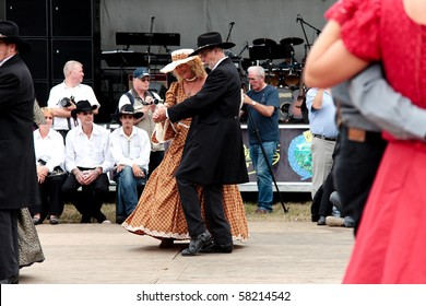 BREDENE , BELGIUM - JULY 31: Participants in the Country & Western sing/dance weekend wear traditional western outfits July 31, 2010 in Bredene , Belgium