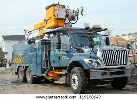 BREEZY POINT, NY - NOVEMBER 15: Canadian electrical company Hydro Quebec truck helping to restore lost power in the aftermath of Hurricane Sandy on November 15, 2012 in Breezy Point, NY