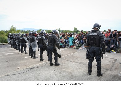 Bregana, Slovenia - September 20, 2015 : The police watching the syrian refugees on the blocked slovenian border with Croatia. The migrants are waiting for the authorities to open the border crossing.