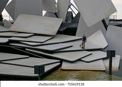 """BREGENZ, VORARLBERG, AUSTRIA - AUGUST 6, 2017: Workman inspects floating open-air theater stage with playing cards, ready for the opera """"Carmen"""" by Georges Bizet, before the performance"""