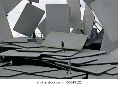"""BREGENZ, VORARLBERG, AUSTRIA - AUGUST 6, 2017: Workmen inspect floating open-air theater stage with playing cards, ready for the opera """"Carmen"""" by Georges Bizet, before the performance"""