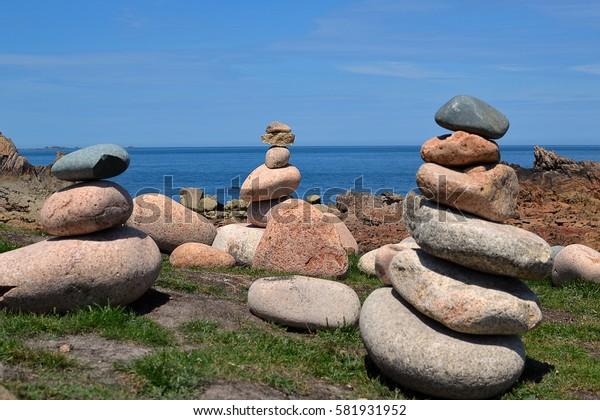 Brehat island: cairn on the wild coast of brehat island