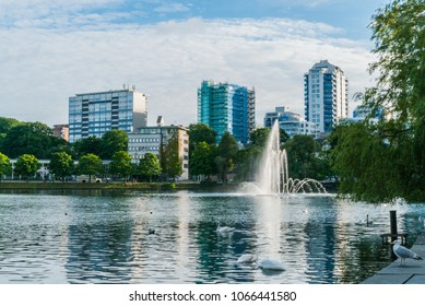 Breiavatnet lake in the center of Stavanger, Norway, and the hotel and bussiness buildings situated by the water. Picture taken on a sunny day in summer.