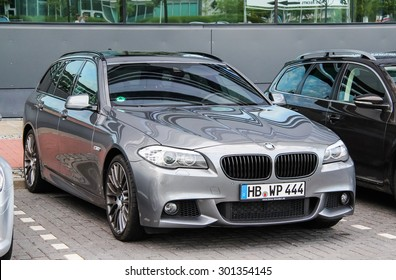 BREMEN, GERMANY - AUGUST 10, 2014: Modern estate car BMW F11 5-series at the city street.