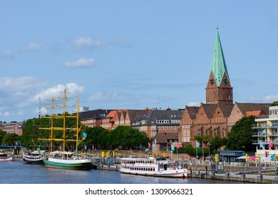 Bremen, Germany - August 22, 2017: City view of the river Weser with three-master Alexander von humboldt and st. martini church