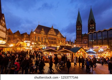 "Bremen, Germany - December 09, 2018: scenic wide angle picture of the traditional Christmas market at the market square in front of the town hall and cathedral ""St. Petri"" during blue hour at dawn"
