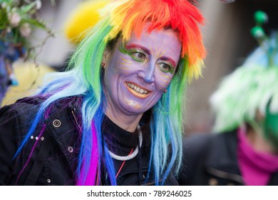 Bremen, Germany - February 18 2017: portrait of a woman with toupee in rainbow colors at carnival