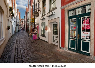 """Bremen, Germany - July 15, 2018: the historic narrow pedestrian street """"Schnoor"""" in the old city of Bremen at a sunny summer day"""
