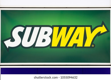 Bremen, Germany - July 31, 2015: Subway logo on a wall. Subway is an American fast food restaurant franchise that primarily sells submarine sandwiches and salads