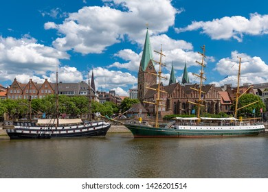 Bremen, Germany - June 13, 2019: The river Weser and the promenade with historic ships.