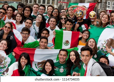 Bremen, Germany - June 17, 2018: crowd of cheering Mexican fans with flags after their national soccer team has won a match in world cup against Germany
