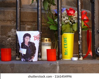 Bremen, Germany - June 27, 2010: Fans remember Michael Jackson one year after his death with a self made memorial with flowers, candles and photo