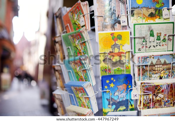 BREMEN, GERMANY - MARCH 23, 2013: Various postcards from Bremen displayed at souvenir shop