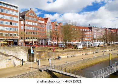 BREMEN, GERMANY - MARCH 23, 2016: Historic facades of houses on embankment of Weser river in Bremen, Germany. In July 2004 Bremen old town was listed as a UNESCO World Heritage Site.
