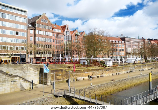 BREMEN, GERMANY - MARCH 23, 2016: Embarktment of Weser river in Bremen is very popular among tourists. Many shops and restaurants can be found there.