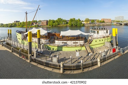 BREMEN, GERMANY - MAY 12, 2016: River Weser with ship MS Treue anchored at river bank. The MS Treue can be hired for partys and is the club ship of Bremen.