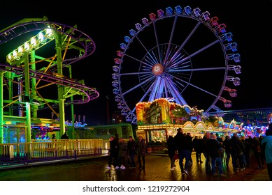"Bremen, Germany - November 01, 2018: giant wheel on the fairground ""Freimarkt"" after rain at night"