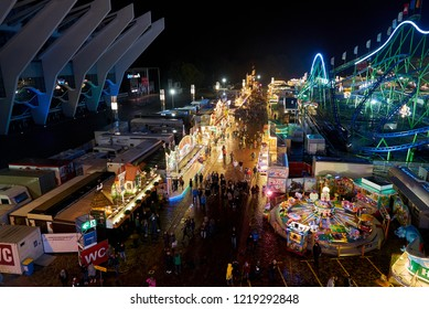 "Bremen, Germany - November 01, 2018: aerial view over the fairground ""Freimarkt"" at night, the facade of the ""ÖVB-Arena"" aka ""Stadthalle"" can be seen on the left"