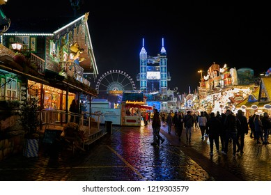 "Bremen, Germany - November 01, 2018: view of the fairground ""Freimarkt"" at night, the lights reflect on the wet ground"