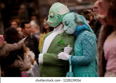 Bremen, Germany - November 11, 2018: couple with fancy fish costumes shows togetherness while the opening event of the carnival season