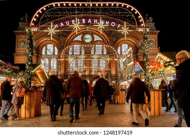 Bremen, Germany - November 30, 2018: facade of the entrance building of the main railway station at night with beautiful enlightened christmas decoration and market stalls