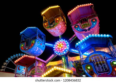 """Bremen, Germany - October 19, 2018: colorful small giant whell for children at the fairground """"Freimarkt"""" at night"""