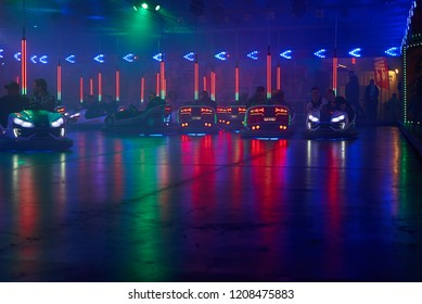 "Bremen, Germany - October 19, 2018: Bumper cars on the fairground ""Freimaak"" at night"