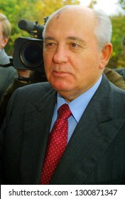 Bremen, Germany - October 1997: close up portrait of former chief of the Soviet Union, Mikhail Gorbachev with in front of green background and TV camera lens - scanned from analog negative film