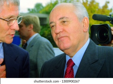 Bremen, Germany - October 1997: portrait of former chief of the Soviet Union, Mikhail Gorbachev next to representative of the institute for Eastern European studies - scanned from analog negative film