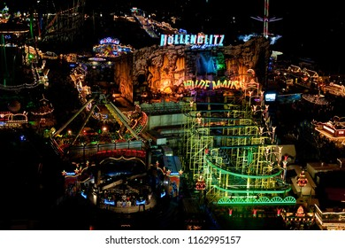 """Bremen, Germany - October 30, 2010: aerial view of the fairground """"Bremer Freimarkt"""" at night with beautiful colorful lighted carousels and attractions"""