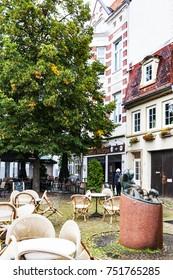BREMEN, GERMANY - SEPTEMBER 16, 2017: empty outdoor cafe in Schnoor quarter in rain. Schnoor is a district in the medieval centre of Bremen city
