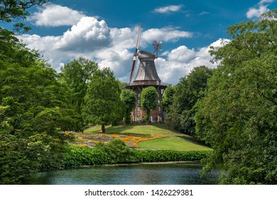 Bremen, Germany. The Wallanlagen Park with historic windmill dating back over a century.