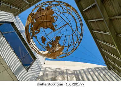 """Bremerhaven, Germany - February 03, 2019: metal sculpture of the earth hangs above the entrance of the museum """"Deutsches Auswandererhaus"""" (German Emigration Center)"""