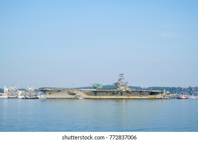 Bremerton, WA USA Dec. 10, 2017: US Navy aircraft carrier USS Nimitz (CVN 68) returns to Naval Base Kitsap for repairs and maintenance after a six month deployment to the middle east
