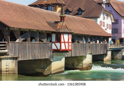 Bremgarten, Switzerland - June 16, 2018: medieval covered bridge over the Reuss river, buildings of the historic part of the town. Bremgarten is a municipality in the Swiss canton of Aargau.